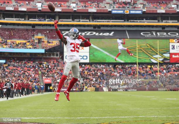 Free safety Curtis Riley of the New York Giants jumps into the end zone for a touchdown after an interception in the first quarter against the...