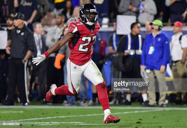 Free safety Damontae Kazee of the Atlanta Falcons celebrates a fumble recovery on a kick return during the first quarter of the NFC Wild Card Playoff...
