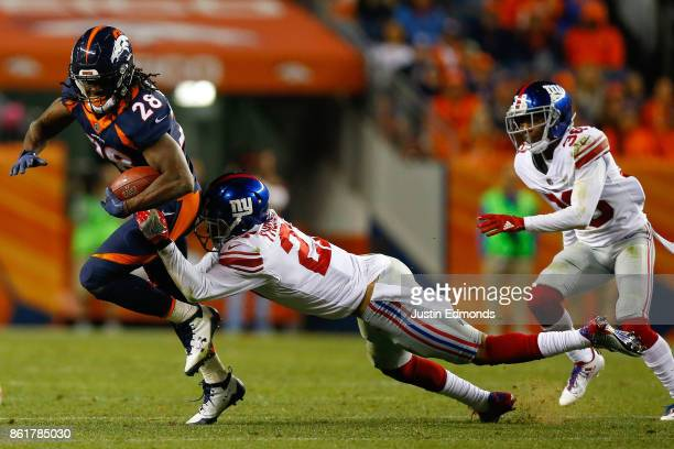 Free safety Darian Thompson of the New York Giants tackles Running back Jamaal Charles of the Denver Broncos during the third quarter at Sports...