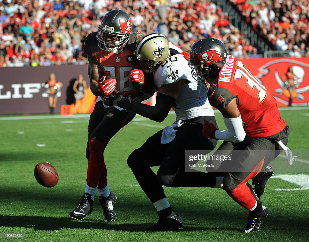 Free safety Dashon Goldson #38 of the Tampa Bay Buccaneers and strong safety Bradley McDougald #30 of the Tampa Bay Buccaneers break up a pass intended for tight end Jimmy Graham #80 of the New Orleans Saints in the fourth quarter at Raymond James Stadium on December 28, 2014 in Tampa, Florida.