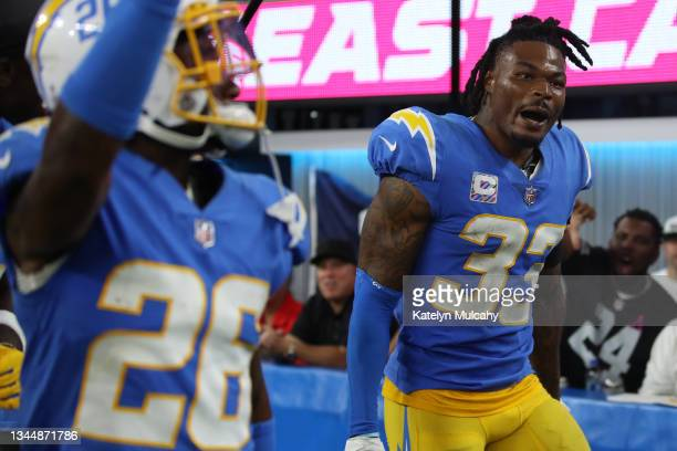 Free safety Derwin James of the Los Angeles Chargers celebrates after his interception against the Las Vegas Raiders during the fourth quarter at...