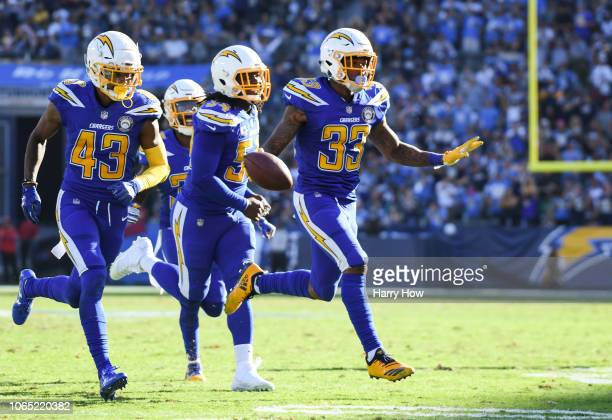 Free safety Derwin James of the Los Angeles Chargers celebrates his interception in the second quarter against the Arizona Cardinals at StubHub...
