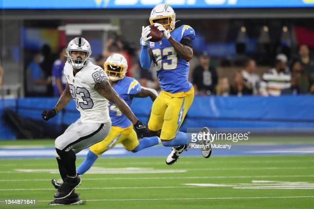 Free safety Derwin James of the Los Angeles Chargers intercepts a pass intended for tight end Darren Waller of the Las Vegas Raiders during the...