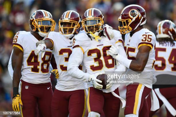 Free safety DJ Swearinger of the Washington Redskins celebrates with his teammates after recovering a fumble in the first quarter against the Dallas...