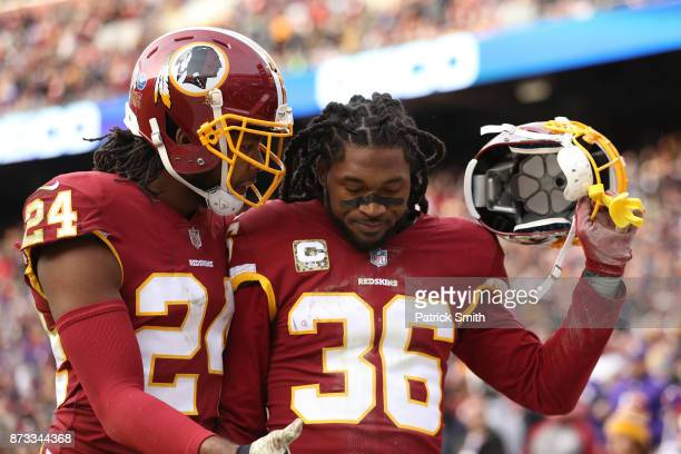 Free safety DJ Swearinger of the Washington Redskins celebrates with cornerback Josh Norman of the Washington Redskins after an interception during...