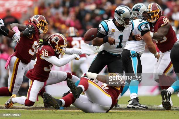 Free Safety DJ Swearinger of the Washington Redskins forces a fumble on quarterback Cam Newton of the Carolina Panthers at FedExField on October 14...