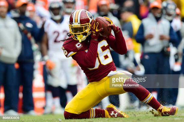 Free safety DJ Swearinger of the Washington Redskins intercepts a pass thrown by quarterback Brock Osweiler in the second quarter at FedExField on...