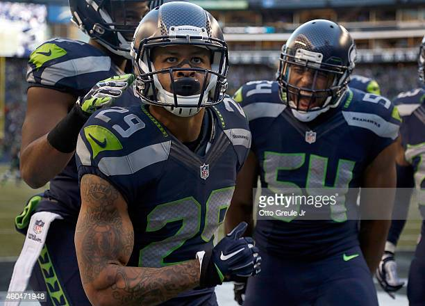 Free safety Earl Thomas of the Seattle Seahawks celebrates with middle linebacker Bobby Wagner of the Seattle Seahawks after Thomas made a play on a...