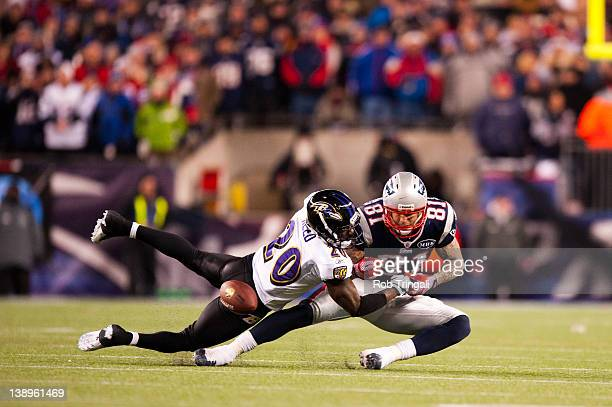 Free safety Ed Reed of the Baltimore Ravens blocks tight end Aaron Hernandez of the New England Patriots from receiving the ball during the AFC...