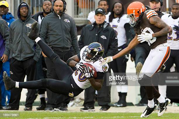 Free safety Ed Reed of the Baltimore Ravens catches an interception intended for wide receiver Travis Benjamin of the Cleveland Browns during the...