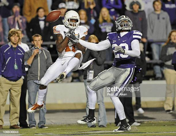 Free safety Emmanuel Lamur of the Kansas State Wildcats brakes up a pass intended for wide receiver James Kirkendoll of the Texas Longhorns during...
