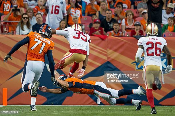 Free safety Eric Reid of the San Francisco 49ers leaps over an attempted tackle by quarterback Trevor Siemian of the Denver Broncos after...