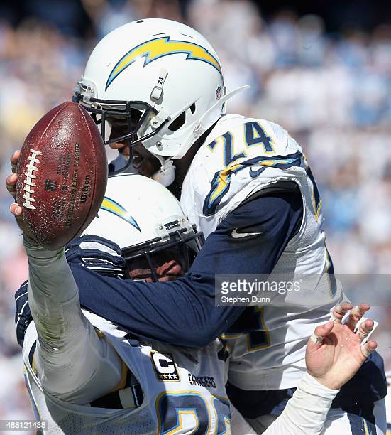 Free safety Eric Weddle is congratulated by cornerback Brandon Flowers of the San Diego Chargers after recovering a fumble by the Detroit Lions at...