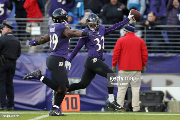 Free Safety Eric Weddle of the Baltimore Ravens returns an interception for a touchdown in the fourth quarter against the Detroit Lions at MT Bank...