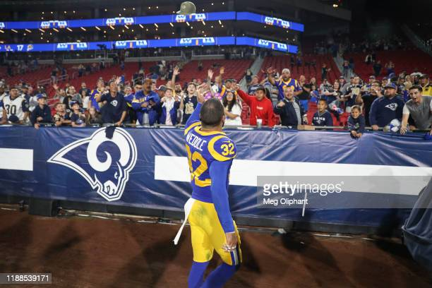 Free safety Eric Weddle of the Los Angeles Rams throws a hat to fans after the game against the Chicago Bears at Los Angeles Memorial Coliseum on...