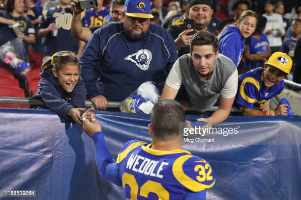 Free safety Eric Weddle of the Los Angeles Rams visits with fans after the game against the Chicago Bears at Los Angeles Memorial Coliseum on...