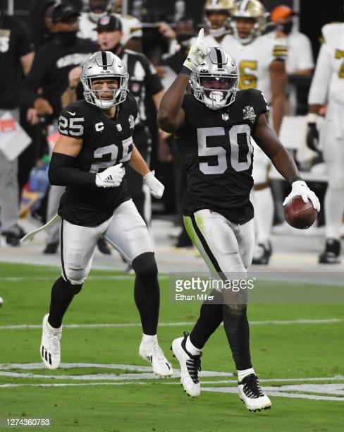 Free safety Erik Harris and linebacker Nicholas Morrow of the Las Vegas Raiders celebrate after Morrow intercepted a pass from quarterback Drew Brees...