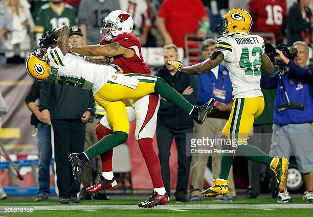 Free safety Ha Ha ClintonDix of the Green Bay Packers hauls in a third quarter interception over wide receiver Michael Floyd of the Arizona Cardinals...