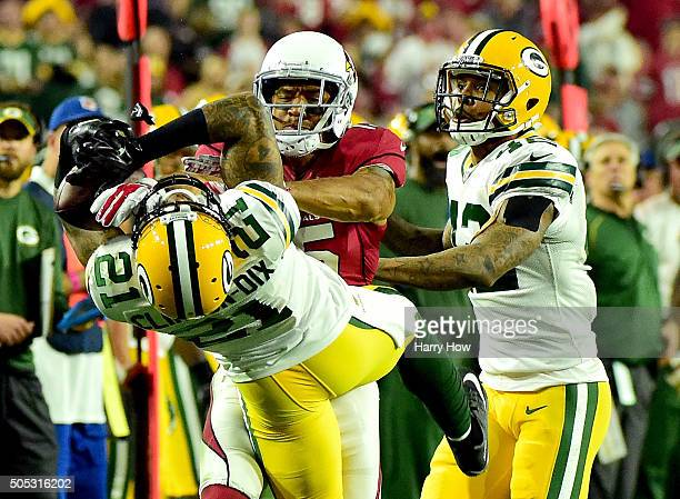 Free safety Ha Ha Clinton-Dix of the Green Bay Packers hauls in a third quarter interception over wide receiver Michael Floyd of the Arizona...