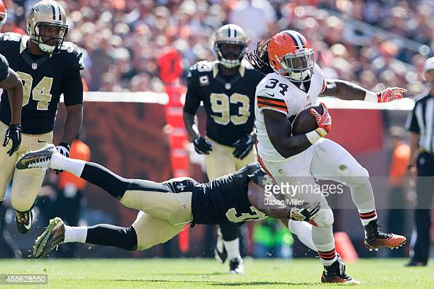 Free safety Jairus Byrd of the New Orleans Saints tries to tackle running back Isaiah Crowell of the Cleveland Browns as he caries the ball during...