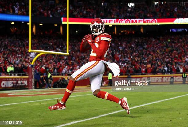 Free safety Juan Thornhill of the Kansas City Chiefs high-steps as he heads for the endzone to score a touchdown after intercepting a pass during the...