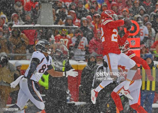 Free safety Juan Thornhill of the Kansas City Chiefs intercepts a pass intended for tight end Noah Fant of the Denver Broncos during the second half...