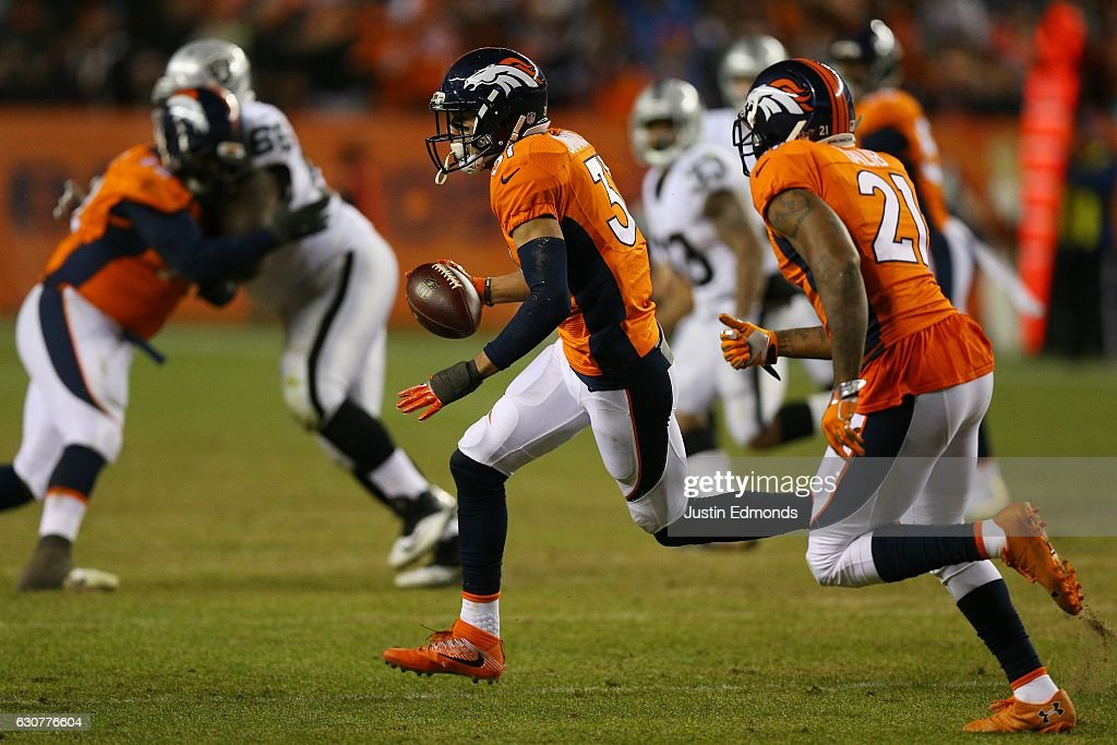 Free safety Justin Simmons #31 of the Denver Broncos intercepts the ball in the fourth quarter of the game against the Oakland Raiders at Sports Authority Field at Mile High on January 1, 2017 in Denver, Colorado.