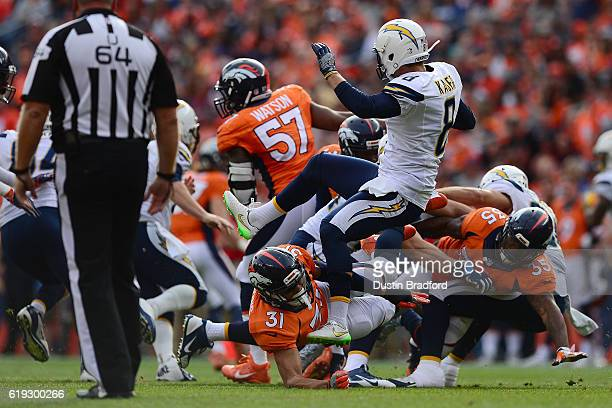 Free safety Justin Simmons of the Denver Broncos is called for roughing the kicker against punter Drew Kaser of the San Diego Chargers in the second...