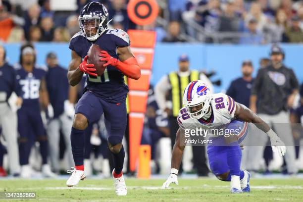 Free safety Kevin Byard of the Tennessee Titans intercepts a pass in front of running back Zack Moss of the Buffalo Bills during the first half at...