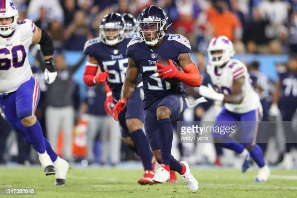 Free safety Kevin Byard of the Tennessee Titans rushes with the ball after an interception against the Buffalo Bills during the first half at Nissan...