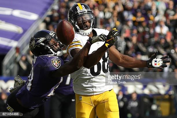 Free safety Lardarius Webb of the Baltimore Ravens breaks up a pass intended for wide receiver Darrius Heyward-Bey of the Pittsburgh Steelers in the...
