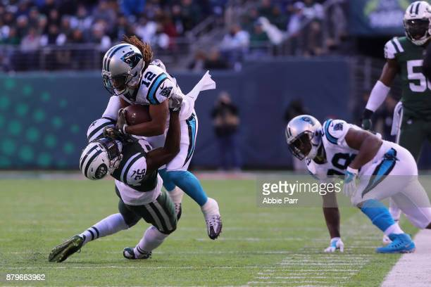 Free safety Marcus Maye of the New York Jets tackles wide receiver Kaelin Clay of the Carolina Panthers during the first half of the game at MetLife...