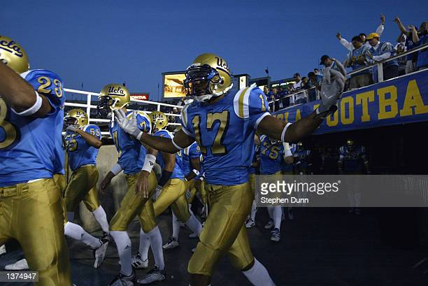 Free safety Matt Ware of the UCLA Bruins jogs out of the tunnel with his teammates before the NCAA football game against the Colorado State Rams on...