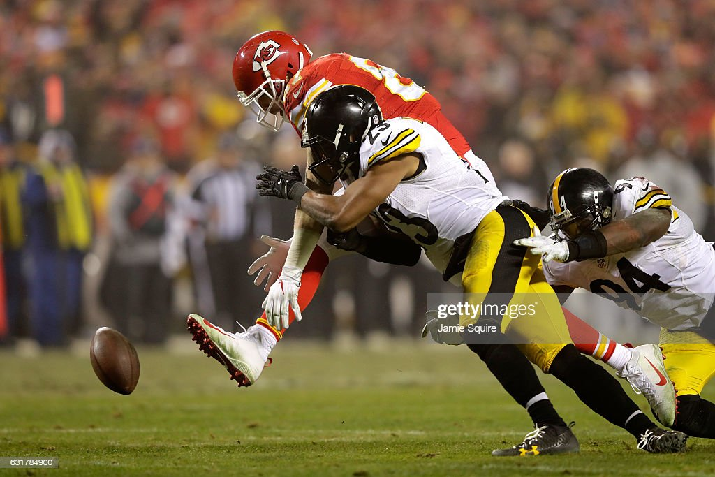 Free safety Mike Mitchell #23 of the Pittsburgh Steelers breaks up a pass catch attempt from tight end Travis Kelce #87 of the Kansas City Chiefs during the second half in the AFC Divisional Playoff game at Arrowhead Stadium on January 15, 2017 in Kansas City, Missouri.