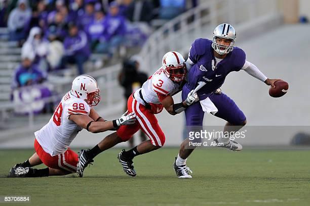 Free safety Rickey Thenarse and defensive end Zach Potter of the Nebraska Cornhuskers sack quarterback Josh Freeman of the Kansas State Wildcats...