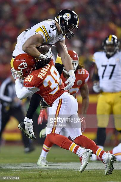 Free safety Ron Parker of the Kansas City Chiefs makes a tackle on tight end Jesse James of the Pittsburgh Steelers during the first quarter in the...