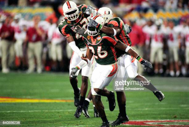 Free safety Sean Taylor of the University of Miami is congratulated after his second quarter interception against Ohio State University during the...