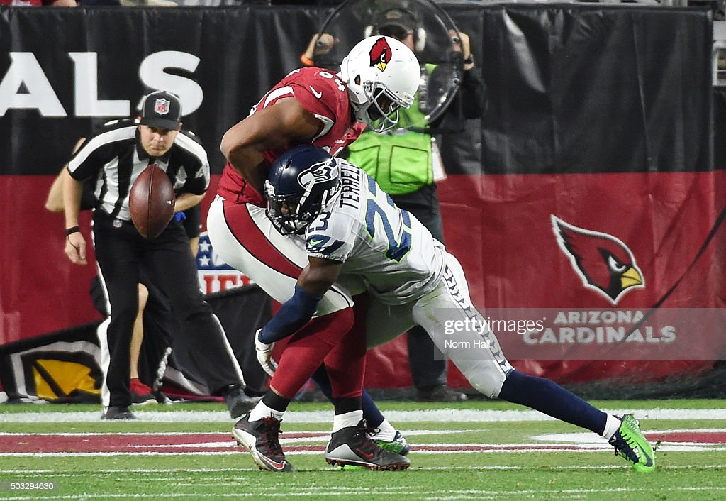 Free safety Steven Terrell #23 of the Seattle Seahawks hits tight end Jermaine Gresham #84 of the Arizona Cardinals to prevent a catch in the second half of the NFL game at University of Phoenix Stadium on January 3, 2016 in Glendale, Arizona. The Seahawks defeated the Cardinals 36-6.