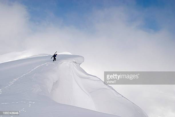 free skier checking the terrain before a descent - steep stock photos and pictures