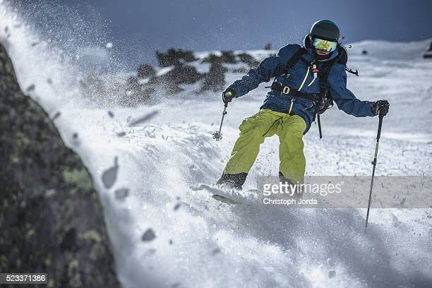 Free skier riding through the powder snow
