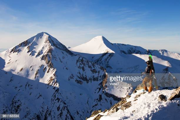 free skier standing on the top of the mountain - pirin mountains stock pictures, royalty-free photos & images