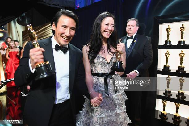 Free Solo filmmakers Jimmy Chin and Elizabeth Chai Vasarhelyi pose with awards backstage during the 91st Annual Academy Awards at the Dolby Theatre...