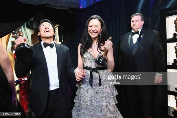 Free Solo filmmakers Jimmy Chin and Elizabeth Chai Vasarhelyi pose with the Best Documentary Feature award for 'Free Solo' backstage during the 91st...