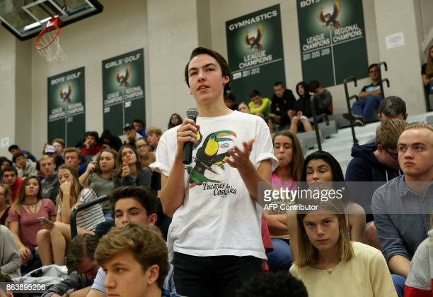 Free State High School student Chris Pendry asks as question during a forum with the four teenage candidates for Kansas Governor at Free State High...