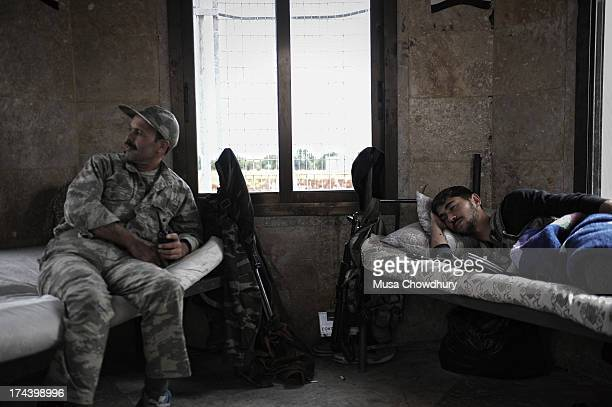 Free Syrian Army checkpoint along the border of Syria and Turkey. The Free Syrian Army members are hardly paid and in most cases have to work around...