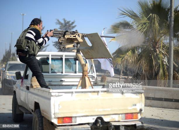 Free Syrian Army fighter fires with a machine gun installed on a truck in AlBab town of Aleppo during the 171th day of the Operation Euphrates Shield...