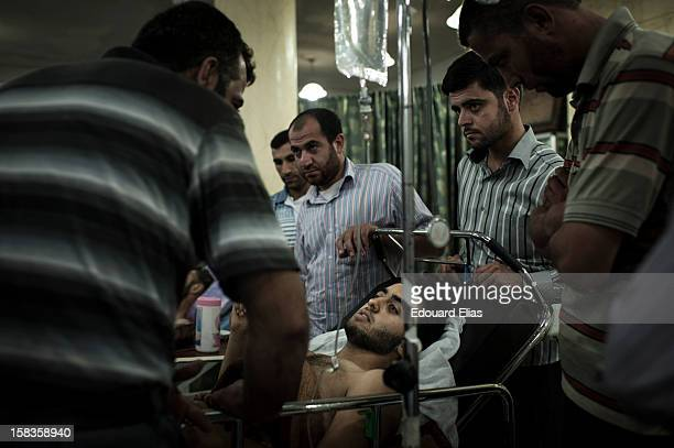 Free Syrian Army fighter receives treament for his wounds in a field hospital near Aleppo on August 16 2012 in Aleppo Syria Government forces loyal...