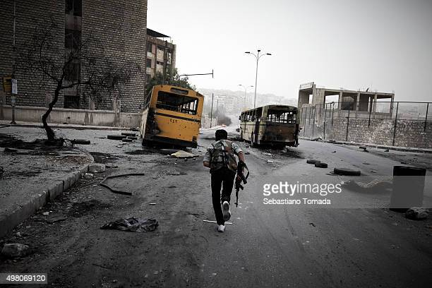 Free Syrian Army fighter runs along one of Aleppo's kinetic front lines October 21 2012