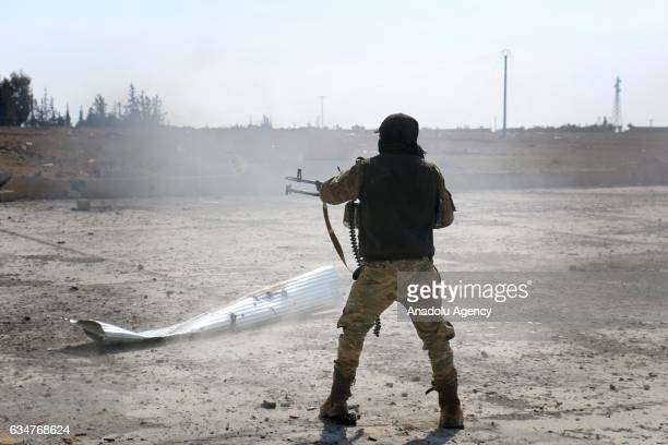 Free Syrian Army fighter supported by the Turkish Armed Forces clashes with Daesh terrorists in AlBab town of Aleppo during the 172th day of the...