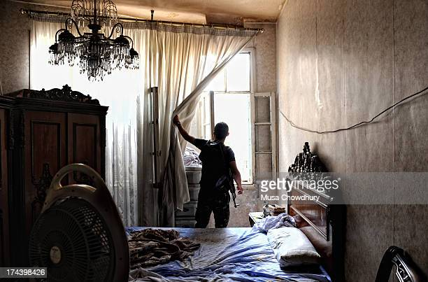 Free Syrian Army fighter wakes up to a new morning. Intense fighting between the FSA and regime forces has lead to street to street battles, leaving...
